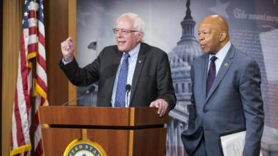 "Democratic presidential candidate Sen. Bernie Sanders (I-VT) and Rep. Elijah Cummings (D-MD) hold a news conference to discuss ""legislation to lower drug prices and increase access to medications"" on Capitol Hill in Washington September 10, 2015.      REUTERS/Joshua Roberts"